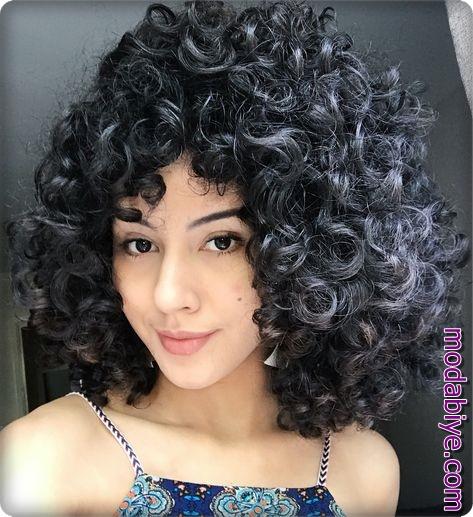 Uzun siyah saça perma uygulaması